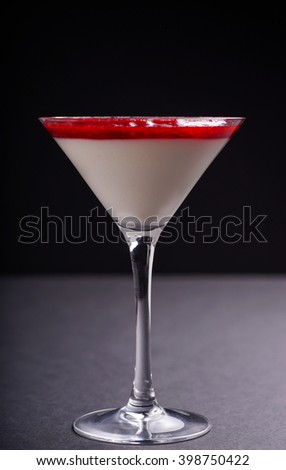 Raspberry and Strawberry cheesecake served as dessert in a glass, isolated on Black background