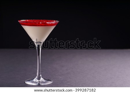 Raspberry and Strawberry cheesecake served as dessert in a glass, isolated on Black background - stock photo