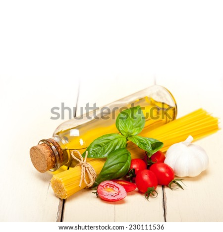 raw ingredients spaghetti pasta tomato and basil foundations of Italian cuisine - stock photo