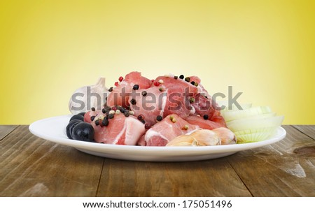 raw meat served on plate - stock photo
