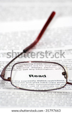 """Read"" word focused thought glasses - stock photo"