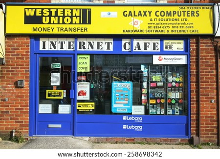 Reading,England - March 6, 2015: Computer hardware and software business in Reading, England providing an Internet Cafe, Western Union money transfers and mobile phone services in the High Street. - stock photo