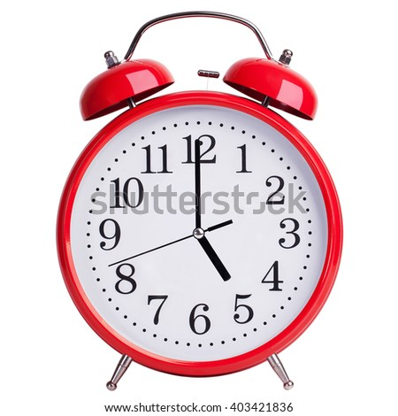 Red alarm clock shows exactly five o'clock - stock photo