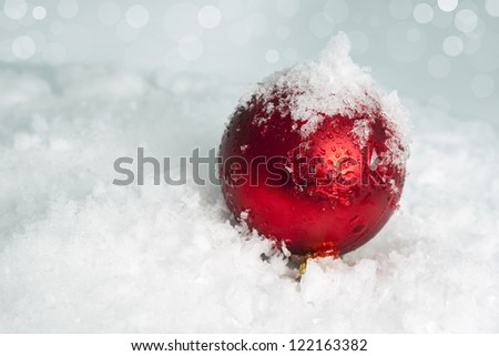 Red  ball  in snow. Christmas background - stock photo