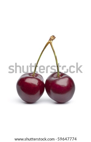 Red cherry twin on stalks on white background
