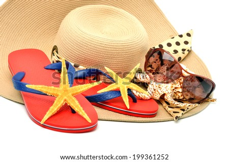 red flip flops with starfishes, sunglasses  and a seashell isolated on white - stock photo