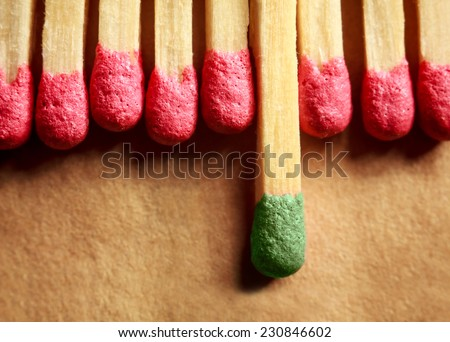 8 red matches and one green - stock photo