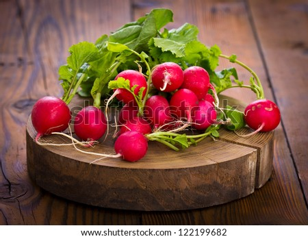 Red radish on the wooden table - stock photo