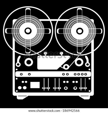reel tape recorder on black background - stock photo