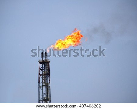 refinery fire gas torch on sky background - stock photo