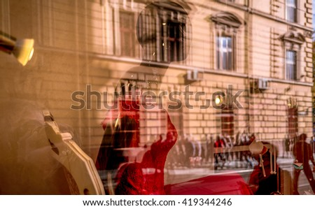 . Reflection of Lviv city arcitecture in showcase window.One shot picture  post dexeloped in lightroom