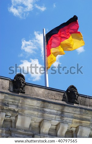 Reichstag - German Parliament with Germany flag.