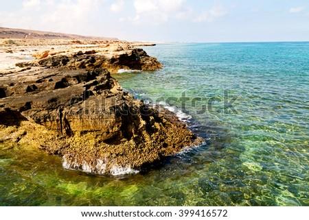 relax near sky in oman coastline sea ocean  gulf rock and beach - stock photo