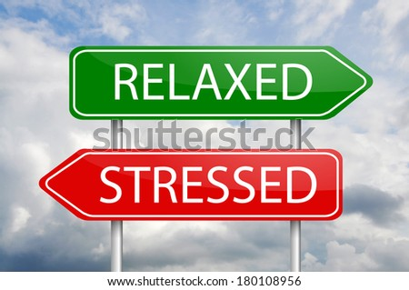"""""""Relaxed"""" and """"Stresses"""" green and red arrow post signs - stock photo"""