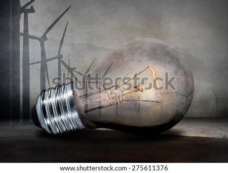 Renewable energy concept. Electric bulb and windmill generators.  - stock photo