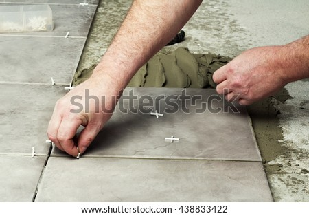 Renovation - construction worker laying tile