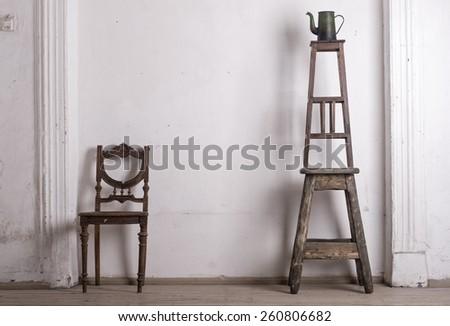 retro chair against a white wall. - stock photo