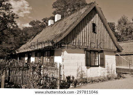Retro postcard - Farm, white wooden buildings of the area of the museum  - Lodz, Poland - stock photo