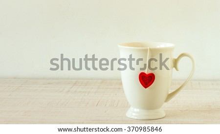 Retro tea cup  for valentines day on wooden table