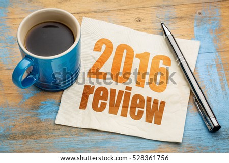 2016 review text on a napkin with a cup of coffee