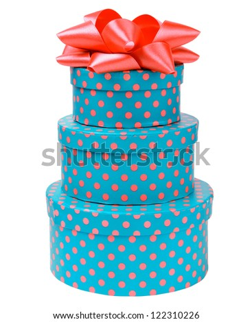 Ribbon bow on three gift boxes with polka dots isolated on white background - stock photo