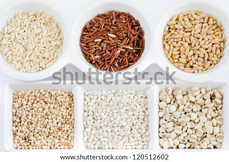 rice , red rice , wheat,  job's tears , barley and millet grains on white bowl - stock photo