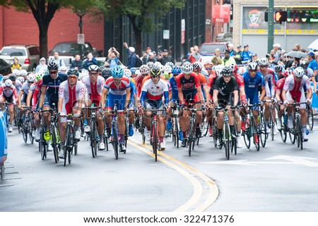 RICHMOND, VIRGINIA - SEPTEMBER 26: Cyclists compete in the junior men's road race at the UCI Road World Championships on September 26, 2015 in Richmond, Virginia   - stock photo