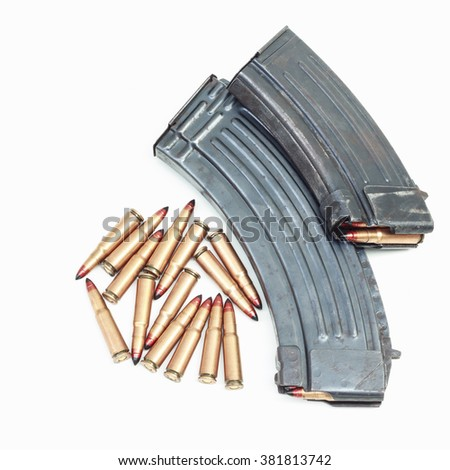 rifle bullet and ammunition pouch on white background - stock photo