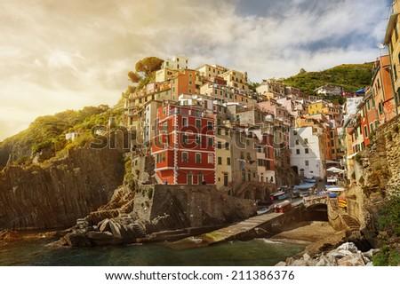 Riomaggiore village under sunset, Liguria, Italy  - stock photo