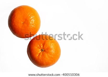 Ripe tangerine closeup on a white background . Mandarin orange on white background . - stock photo