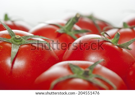 ripe tomatoes on wood surface