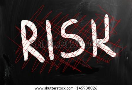 """Risk"" handwritten with white chalk on a blackboard - stock photo"