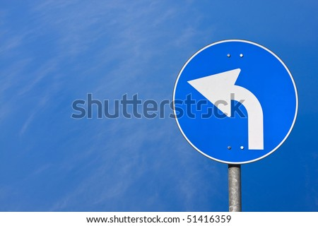 Road sign  on blu sky background - stock photo