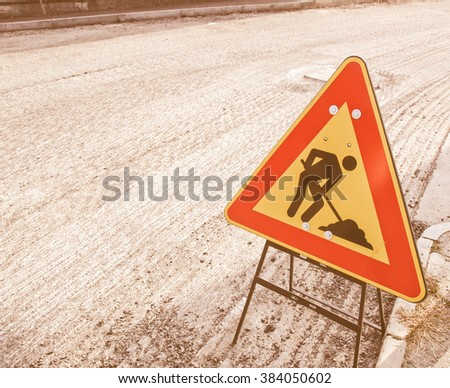Road works traffic sign for construction site vintage