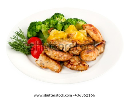 roasted chicken and broccoli with vegetable, herbs and pineapple - stock photo