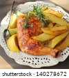 roasted chicken leg with fries potato and lemon - stock photo
