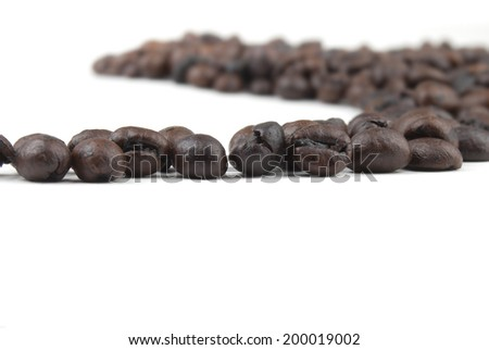 Roasted coffee  macro on white isolated - stock photo