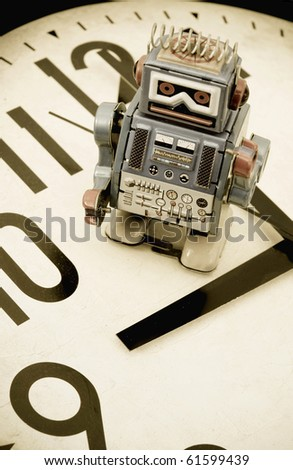 robot on a clock face - stock photo
