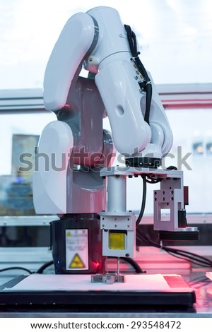 robotic hand for milling machine tool at industrial manufacture factory - stock photo