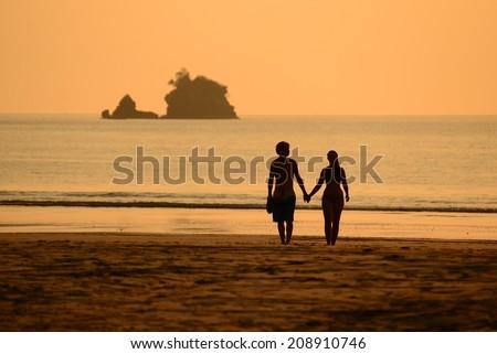 Romantic Couple at Beautiful Sunset  beach, Payam island Ranong - stock photo