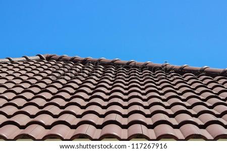 Roof tile landscape view against blue sky - stock photo