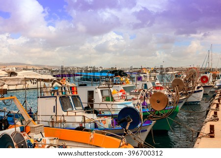 Row of fishing boats in Paphos harbor. - stock photo