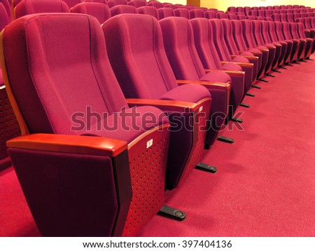 rows of  red chairs in the hall