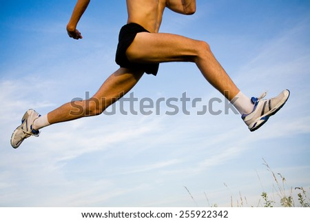 Runner feet running on road closeup. Sportsman. - stock photo