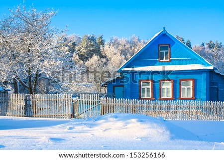 rural house in the winter covered with snow - stock photo