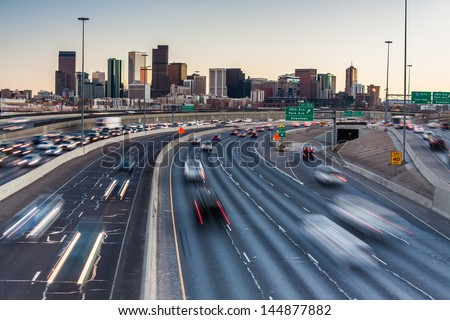 Rush hour traffic on I-25 looking towards downtown Denver, Colorado, USA - stock photo