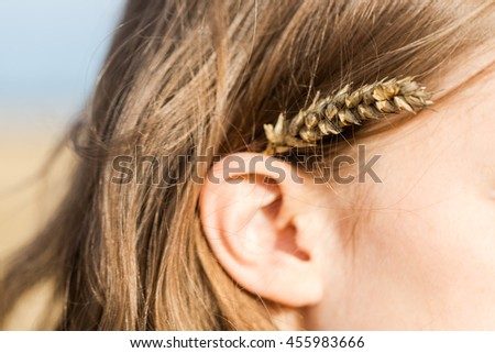 Rye ear in woman hair.