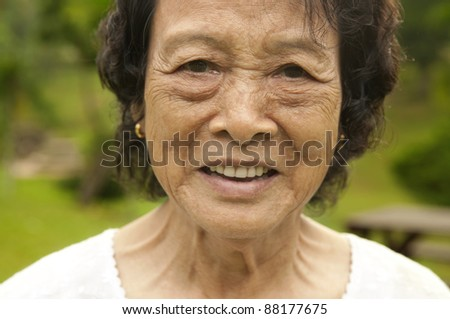 80's Asian senior woman at park in a morning - stock photo
