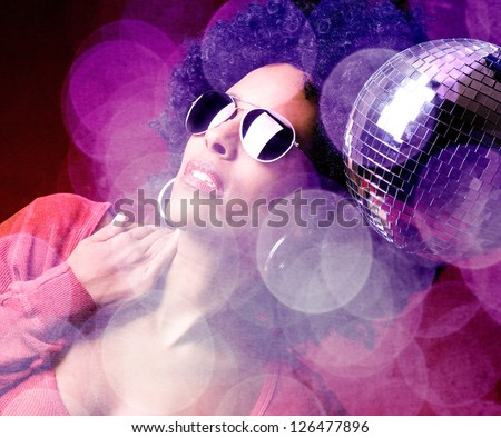 70s disco girl with a disco ball and a big afro hair - stock photo