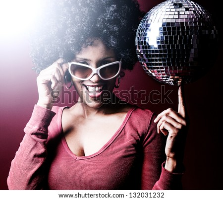 70s disco girl with a disco ball and a big afro hair